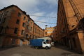 Vintage industrial red brick building in the industrial area of the old European city. Royalty Free Stock Photo