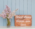 Vintage inspiring poster and bunch of lilac with words romantic gentle on the table Stock Photo