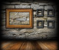 Vintage interior backdrop with frames wooden on grunge stone wall Stock Photography