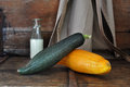 Vintage interior kitchen squash on old wooden bench with milk bottle and apron style Stock Image
