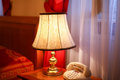 Vintage interior of luxury hotel room in retro style with decorated old lamp and telephone Stock Images