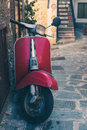 Vintage italian scooter in a alley of historic city center Royalty Free Stock Photo