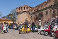 Vintage italian scooters bikers riding a lambretta and vespa with the castle on background at motorcycle rally iv vespa in fiore Royalty Free Stock Images