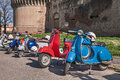Vintage italian scooters vespa parked near the castle during the classic scooter rally iv in fiore on april in imola bo Stock Photo
