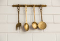 Vintage kitchen spoon  and fork hanging ( Filtered image Royalty Free Stock Photo