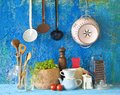 Vintage kitchen utensils various against blue wall traditional cooking concept Royalty Free Stock Photo