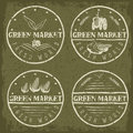 Vintage labels of green market with tractor and vegetable set vegetables Royalty Free Stock Photos