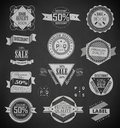 Vintage labels set vector design elements quality and guaranteed drawing with chalk on blackboard Royalty Free Stock Image