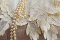 Vintage lace handkerchief and pearls cream Royalty Free Stock Photos