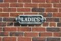 Vintage Ladies Sign on brick wall