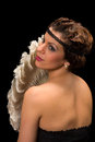 Vintage lady with antique feather fan Royalty Free Stock Photo