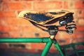 Vintage leather bike saddle with metal spring Royalty Free Stock Photography