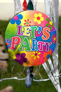 Vintage let s party sign hanging with green and blurred background Stock Photo