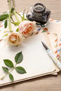Vintage letters, roses and bottle of ink Royalty Free Stock Photo