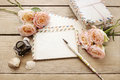 Vintage letters, roses and bottle of ink on wooden table. Royalty Free Stock Photo