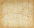 Vintage lined ragged paper sheet with dark borders Royalty Free Stock Photo