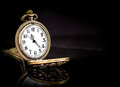 Vintage locket clock gold copper pocket on black background Royalty Free Stock Image