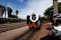 Vintage locomotive steam train against blue sky