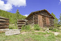Vintage log cabin on farm in the mountains Royalty Free Stock Photo