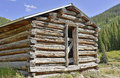 Vintage log cabin in old mining town in the mountains Royalty Free Stock Photo