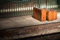 Vintage luggage baggage suitcases on an empty railway platform Royalty Free Stock Photography