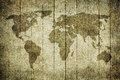 Vintage map of the world over wooden background Royalty Free Stock Photo