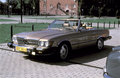 Vintage mercedes sl cabrio old beautifully restored brown metallic parked in tczew northern poland slide scan analogue photography Royalty Free Stock Photos
