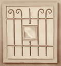 Vintage metal art ornamentation window. sepia filtered image Royalty Free Stock Photo