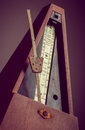 Vintage metronome color shot of a on a black background Royalty Free Stock Photos