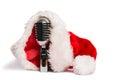 Vintage mic with santa hat on white background Stock Image