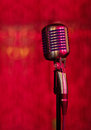 Vintage microphone on red background Royalty Free Stock Photos