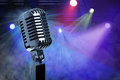 Vintage microphone on stage retro with lighting background Royalty Free Stock Photos