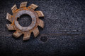 Vintage milling cutter with cogs on wood board