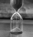 Vintage minutes sandglass or hourglass in black and white style monochrome Stock Photos
