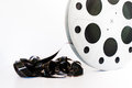 Vintage mm movie film cinema reel on white background unrolled and copy space Stock Photo