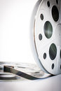 Vintage mm movie film cinema reel on white background unrolled and copy space vertical frame Royalty Free Stock Photo