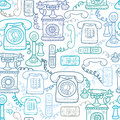 Vintage and modern telephones seamless pattern vector background with hand drawn elements Stock Photos