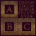 Vintage monogram kit. Golden patterned letters and ornate square frames for creating initial logo in antique style Royalty Free Stock Photo