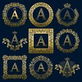 Vintage monograms set of A letter. Golden heraldic logos in wreaths, round and square frames