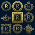 Vintage monograms set of R letter. Golden heraldic logos in wreaths, round and square frames