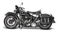 Vintage motorbike sideways shot of a in white back Royalty Free Stock Images