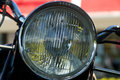 Vintage motorcycle headlight close up of with chrome holder Royalty Free Stock Photos