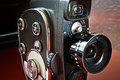 Vintage movie camera with film charged on reels Stock Photos
