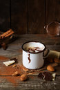 Vintage mug with hot chocolate served chunks of white and dark and almonds on old wooden table Royalty Free Stock Photo