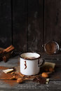 Vintage mug with hot chocolate steaming served chunks of white and dark and almonds on old wooden table Stock Photos