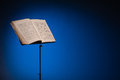 Vintage music stand atmospheric blue background space text Stock Image