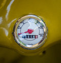Vintage mustard yellow odometer retro speedometer on a moped or scooter Stock Image