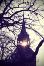 Vintage mysterious or scary tower silhouette at sunset instagram filtered photo of church bell Stock Image