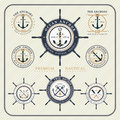 Vintage nautical steering wheel and anchor labels set Royalty Free Stock Photo