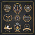 Vintage nautical wreath labels set on dark wood background logo and design element Royalty Free Stock Photos